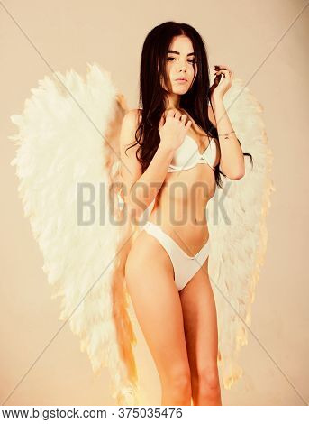 Fashion Model. Femininity And Sensuality. Lingerie Angel Feather Wings Accessory. Erotic Angel. Play