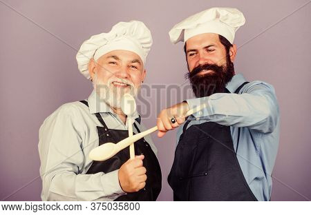 The Nutritional Choice. Taste Food. Culinary Concept. Mature Senior Bearded Men In Kitchen. New Reci