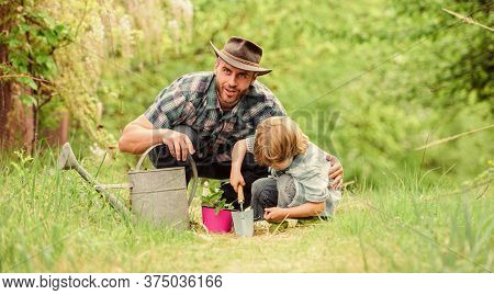 Growing Plants. Take Care Of Plants. Boy And Father In Nature With Watering Can. Gardening Tools. Pl