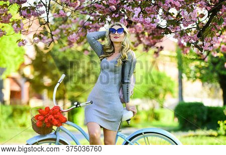 Excursion To Garden. Cherry Tree Blooming. Athletic Woman Ride Retro Bicycle. Rest And Travel. Trave
