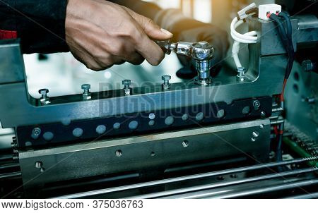 Mechanic Technician Hand Fixing Industrial Machinery In Factory. Professional Technician Service And