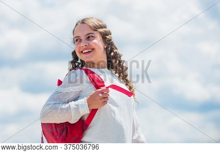 Smiling Student With School Bag. Back To School. Little Girl Carry Backpack. Small Kid On Sunny Sky