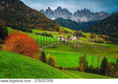 Well Known Alpine Place Of The World, Santa Maddalena Village With Magical Dolomites Mountains In Ba