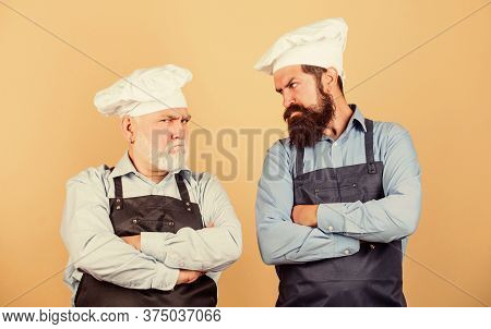 Commercial Kitchen At Restaurant. Professional Chefs. Men In Cook Hat. Mature Bearded Chef. Tired Of