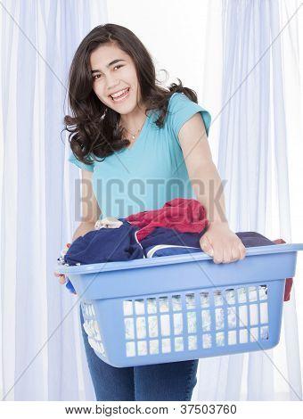 Happy Teen Girl Doing The Laundry