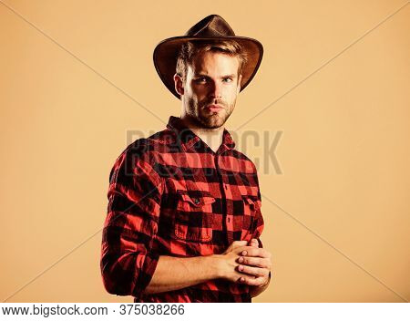 Western Fashion. Wild West Rodeo. Handsome Man In Hat. Man Checkered Shirt On Ranch. Vintage Style M