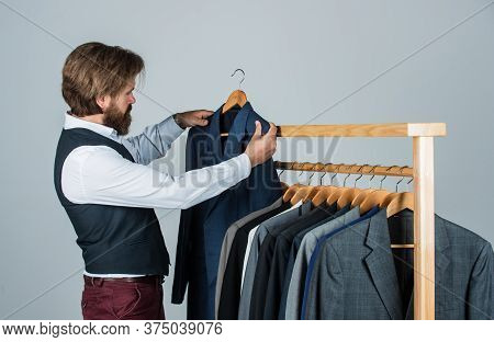 Young Perfectionist. Businessman. Confident Tailor Designing Male Jacket. Handsome Sartor With Tape