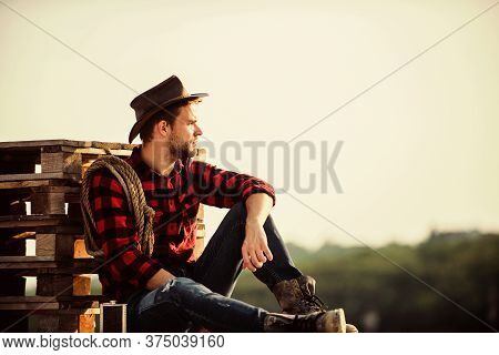 Farmer Cowboy Handsome Man Relaxing After Hard Working Day At Ranch. Farmer Enjoy View From His Farm