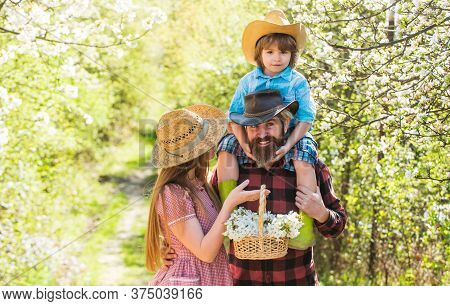 First Flowers. Happy Family Enjoy Spring Time. Family Of Three In Garden. Family Vacation. Family Li