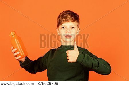 You Will Like This Product. Small Boy Show Thumbs Up For Juice Orange Background. Vitamin Drink. Dri