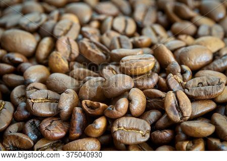 Roasted Coffee Beans On A Kitchen Table