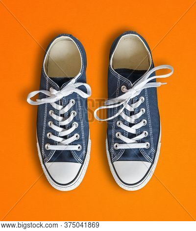 Blue Generic Sneakers Isolated On Orange Background