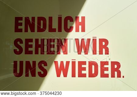 Sign On A Shop Window In Germany With The Words