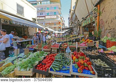 Naples, Italy - June 22, 2014: Local People Shopping At Sunday Street Market Porta Nolana In Napoli,