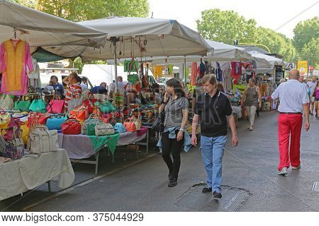 Rome, Italy - June 30, 2014: Street Market Stalls With Cheap Clothing And Fashion Bags In Rome, Ital