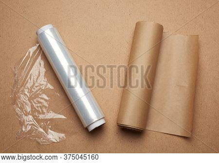 Big Roll Of Wound White Transparent Film For Wrapping Food And Roll Of Brown Craft Paper, Brown Wood