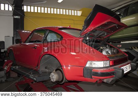 Vigo, Spain - Feb 18, 2020: Engine Of A Red Classic Porsche 911 Coupe Carrera G-modell 915, 1986 On