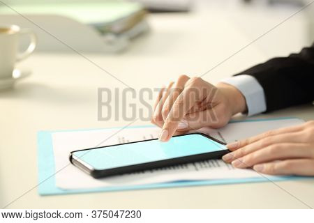 Close Up Of Executive Woman Hand Signing Digital Contract On Smart Phone Lighted Screen With Finger