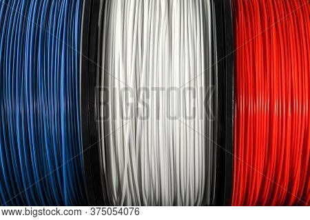 French Flag Of The Coils For 3d Printer. Filament For 3d Printing. Bright Thermoplastic Of Blue, Whi