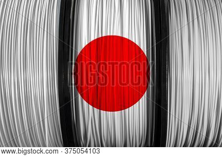 Japan Flag Of The Coils For 3d Printer. Filament For 3d Printing. Bright Thermoplastic Of White And