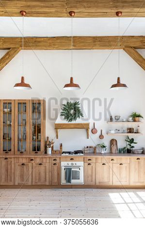 Vertical Photo Of Cozy House With Modern Kitchen Interior, Gas Stove, Oven Appliance, Cooking Hood,