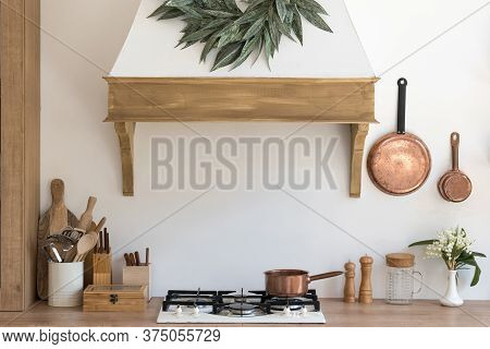Element Of Cozy House With Modern Kitchen Interior, Contemporary Wooden Furniture, Cooking Hood Over