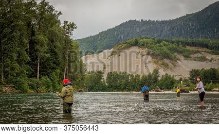Combat Fishing For Salmon On The Kitimat River, On A Summer Morning In British Columbia, Canada