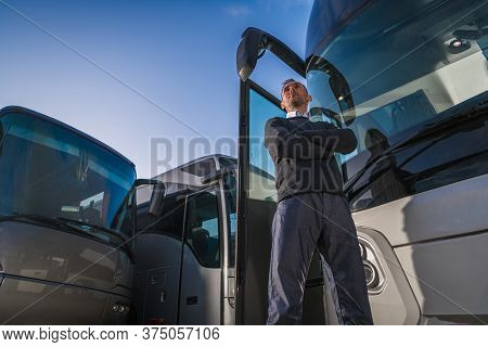 Shuttle Buses Transportation Business Owner In Front Of His Fleet Of Coach Buses. Caucasian Transpor