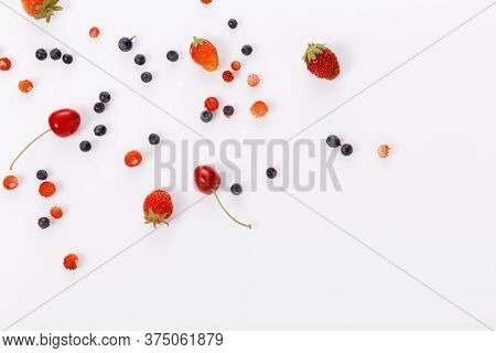 Fresh Summer Berries, Strawberries, Raspberries, Blueberries, Cherries On A White Background