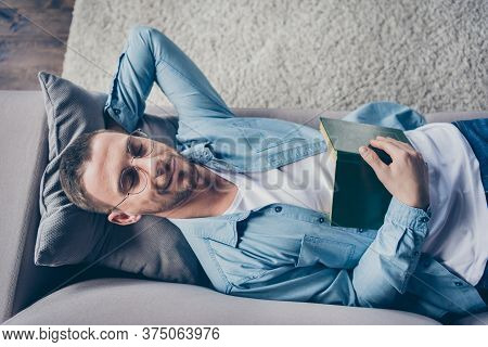 High Angle Above View Photo Of Domestic Handsome Guy Stay Home Quarantine Time Fall Asleep Reader Op