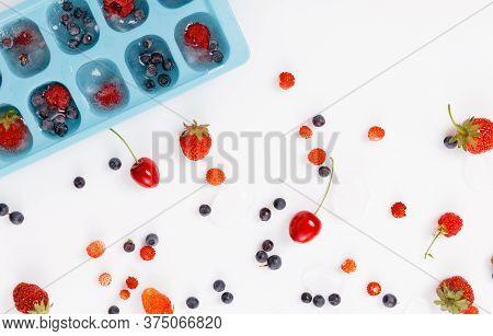 Fresh And Frozen Summer Berries, Strawberries, Raspberries, Blueberries, Cherries On A White Backgro