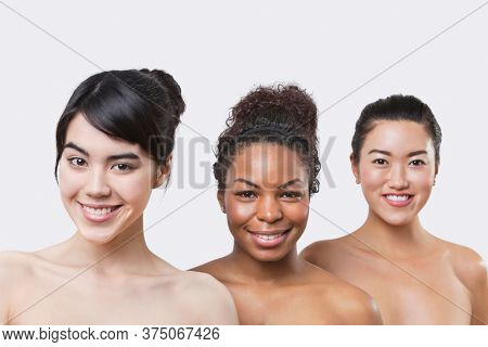 Beauty portrait of three young multi-ethnic women over white background