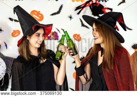 Portrait young adult woman wear halloween costume celebrate a Halloween party carnival Festival and cheers with alcohol beer. Halloween celebrate and international holiday concept.