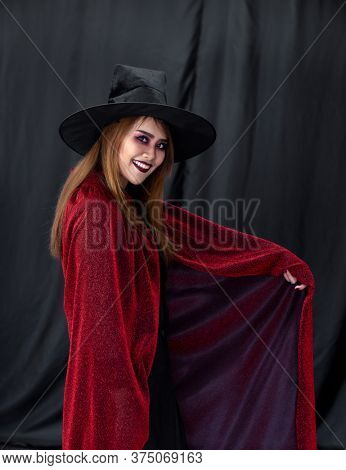 Portrait of young adult teenage woman wear Halloween costume cloth for Halloween party carnival. Halloween celebrate and international holiday concept.