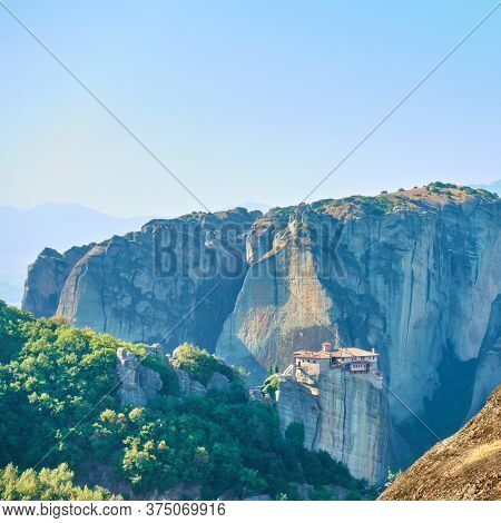 Rocks of Meteora in Greece with Rousanou nunnery on the cliff - Greek landscape