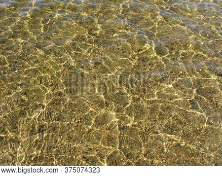Crystal Clear Clear Water, Sandy Bottom Of The Lake