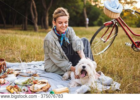 Nice Smiling Girl With Cute Dog Happily Spending Time On Beautif