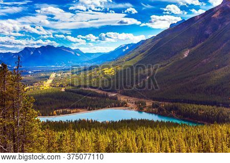 Autumn in the Canadian Rockies. The valley and azure icy water of the Kananaskis river. The concept of active, ecological and photo tourism