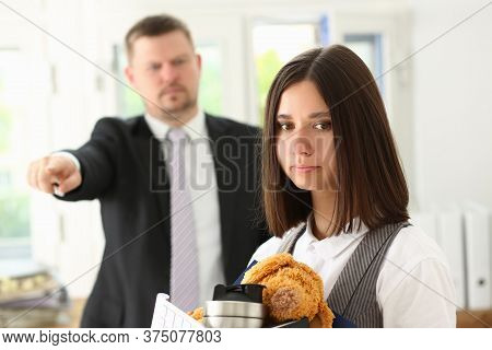 Angry Strict Dissatisfied Male Boss Firing Female Incompetent Employee In The Office While Asking To