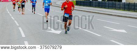 Man Runner Leads Group Of Runners City Marathon Race