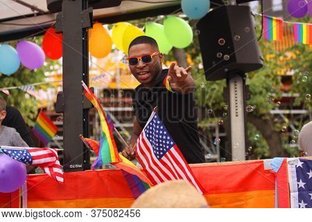 African-american Man Pointing At Pride Parade Lgbt. Impressions From Gay And Lesbians Participating