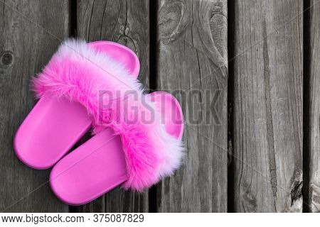 Close-up Girl Or Woman Empty Glamour Fashion Fluffy Fuzzy Slippers Standing On Wooden Floor Board Ba