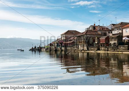 High Tide At The Well-preserved Village Of Combarro In Ponteveda, Spain, Famous For Its Stone Crucei