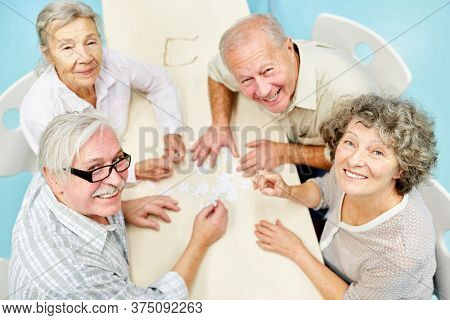 Seniors as a retired group have fun playing in the retirement home or at home