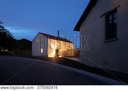 Small holiday home, night situation, romantic image. Great space to write a text in the blue sky