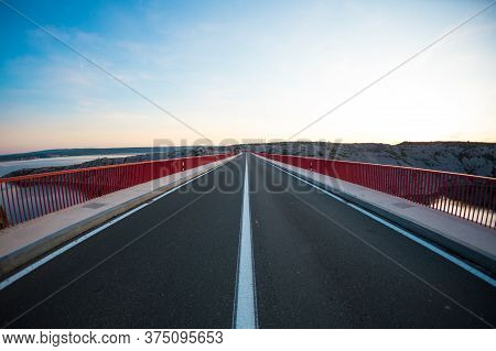 Red Bridge Over The Canyon In Croatia At Sunset. View From The Bridge To The Canyon In The Krka Nati