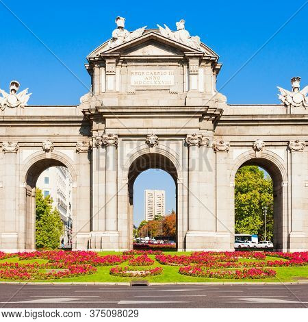 Alcala Gate Or Puerta De Alcala Is A Monument In The Plaza De La Independencia In Madrid, Spain. Mad