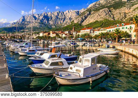 Famous Adriatic coast - Makarska riviera in Dalmatia. Town Makarska, promenade and marine. 17.09.2019