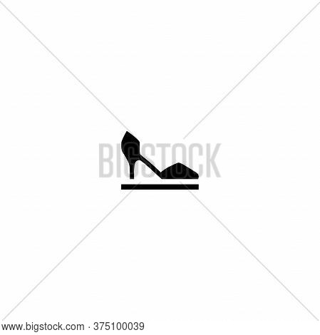 Female Shoe With High Heel On Pedestal. Elegant Black Slipper With Spike Heel On While Background.
