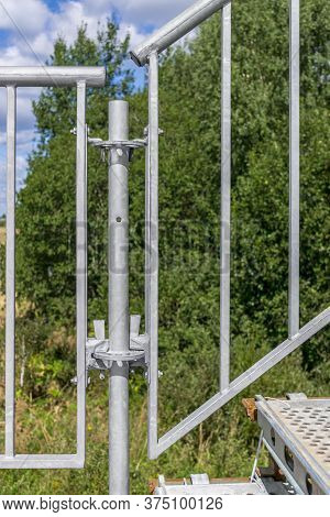 Fastening For To Connect Elements Temporary Metal Structure. Banisters Of Staircase. Sunny Day.